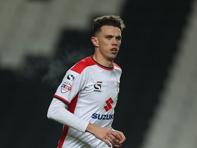 Tom Flanagan of MK Dons in action during the FA Cup Second Round match between MK Dons and Chesterfield at Stadium mk on December 6, 2014