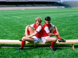 Tony Woodcockand Charlie Nicholas of Arsenal sit on a bench at Highbury in London in July 1983
