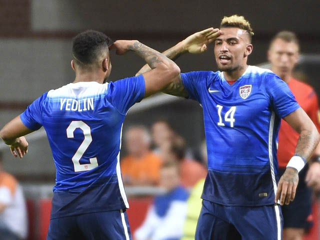 US Danny Williams celebrates with US DeAndre Yedlin after scoring a goal during the friendly football match between the Netherlands and USA on June 5, 2015