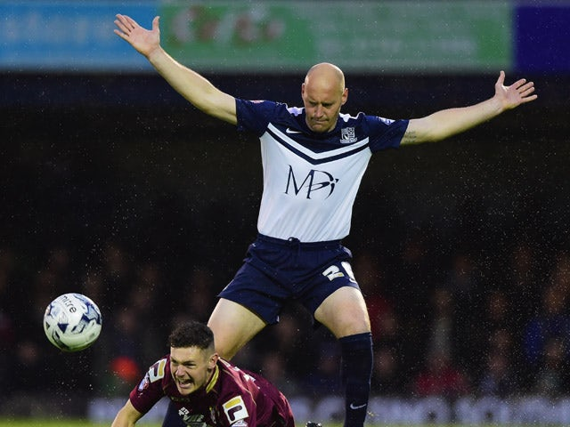 Ben Kennedy of Stevenage is challenged by Adam Barrett of Southend United during the Sky Bet League Two Playoff semi final match between Southend United and Stevenage at Roots Hall on May 14, 2015