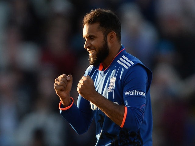 Adil Rashid of England celebrates dismissing Mitchell Santner of New Zealand during the 1st ODI Royal London One-Day match between England and New Zealand at Edgbaston on June 9, 2015
