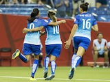 Brazil's Andressa Alves (L), Marta (C) and Rafaelle celebrate after Alves scored against Spain during a Group E match at the 2015 FIFA Women's World Cup at the Olympic Stadium in Montreal on June 13, 2015