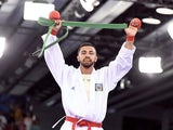Azerbaijan's Aykhan Mamayev reacts after winning the gold medal after competing against Greece's Michail Georgios Tzanos (unseen) in the Men's Karate Kumite -84kg, as part of the 2015 European Games in Baku on June 14, 2015
