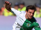 Sporting's defender Cedric Soares (L) tackles Braga's defender Andre Pinto during the Taca de Portugal (Portuguese Cup) football match final Sporting CP vs SC Braga at Jamor stadium in Oeiras, outskirts of Lisbon on May 31, 2015