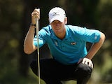 Chris Wood of England putts on the 6th hole during day two of the World Cup of Golf at Royal Melbourne Golf Course on November 22, 2013