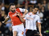 Bryan Ruiz of Fulham battles with Craig Morgan of Rotherham United during the Sky Bet Championship match between Fulham and Rotherham United at Craven Cottage on April 15, 2015