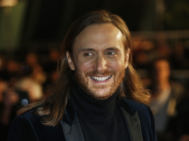 French DJ David Guetta poses upon his arrival at the Palais des Festivals to attend the 16th Annual NRJ Music Awards on December 13, 2014