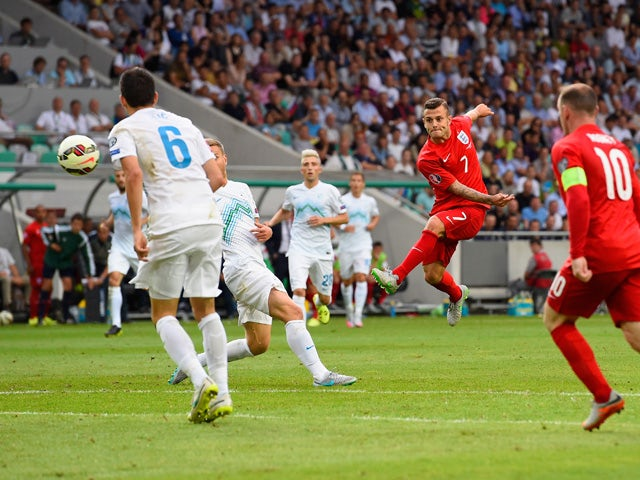 Jack Wilshere of England scores their second goal during the UEFA EURO 2016 Qualifier between Slovenia and England on at the Stozice Arena on June 14, 2015