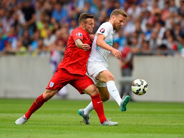 Jack Wilshere of England marshalls Ales Mertelj of Slovenia during the UEFA EURO 2016 Qualifier between Slovenia and England on at the Stozice Arena on June 14, 2015