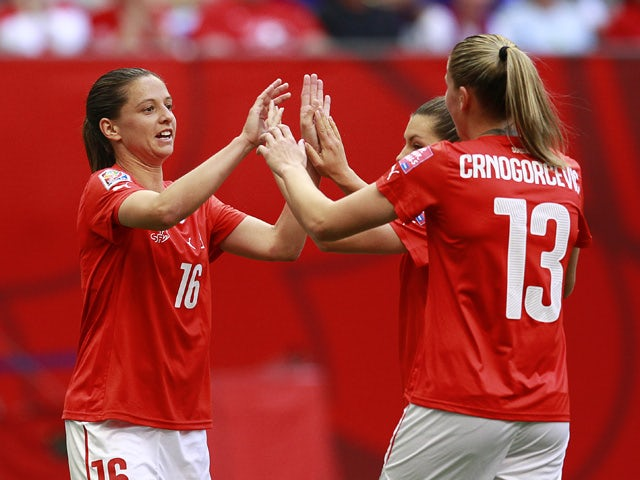 Fabienne Humm #16 and Ana-Maria Crnogorcevic #13 of Switzerland celebrate Switzerland's second goal during the FIFA Women's World Cup Canada 2015 Group C match between Switzerland and Ecuador June 12, 2015