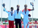 Silver medalist Joao Silva of Portugal, gold medalist Gordon Benson of Great Britain and bronze medalist Rostyslav Pevtsov of Azerbaijan celebrate during the medal ceremony for the Men's Triathlon Final during day two of the Baku 2015 European Games at Bi