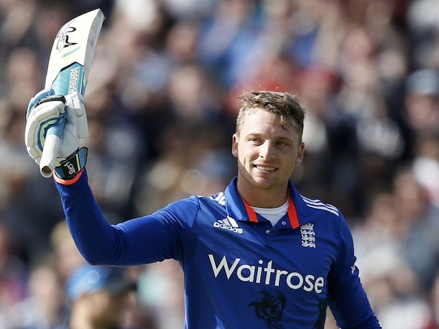England's Jos Buttler (R) celebrates scoring his century during the first one-day international (ODI) cricket match between England and New Zealand at Edgbaston cricket ground, in Birmingham, central England on June 9, 2015