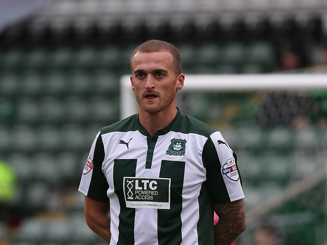 Lewis Alessandra of Plymouth Argyle in action during the Sky Bet League Two match between Plymouth Argyle and Northampton Town at Home Park on March 7, 2015