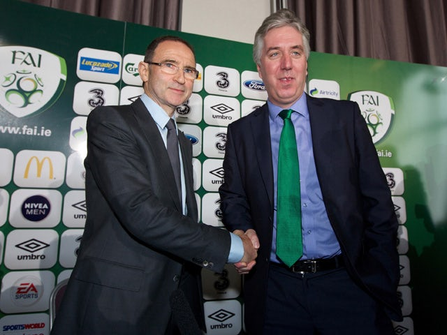 Newly appointed Republic of Ireland manager Martin O'Neill shakes hands with John Delaney, Chief Executive of the FAI during a press conference at Gibson Hotel on November 09, 2013