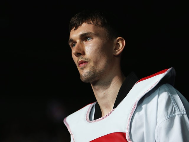 Stamper of Great Britain walks out to compete against Damir Fejzic of Serbia during the Men's -68kg Taekwondo quarterfinal match on Day 13 of the London 2012 Olympic Games at ExCeL on August 9, 2012