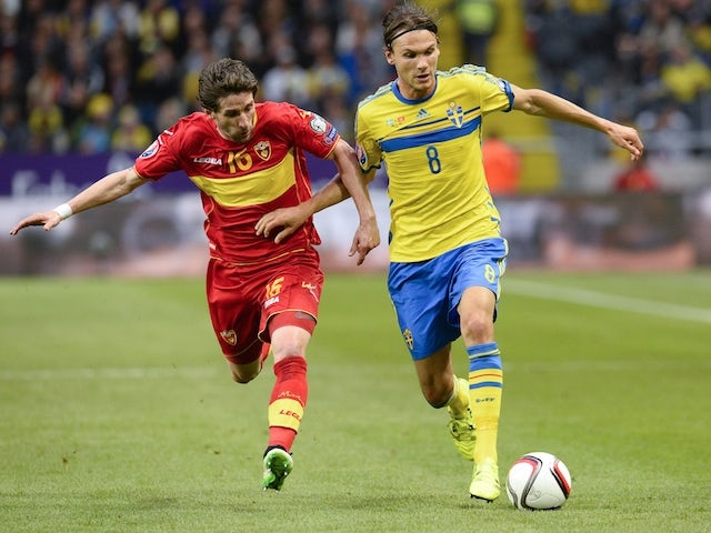 Midfielder Mladen Kascelan (L) of Montenegro vies with midfielder Albin Ekdal of Sweden during the Euro qualifying football match between Sweden and Montenegro at the Friends Arena in Solna near Stockholm on June 14, 2015