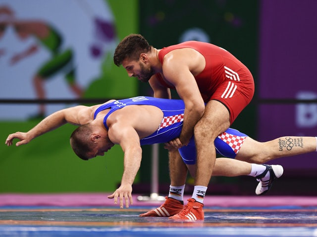 Nenad Zugaj of Croatia (blue) and Ramsin Azizsir of Germany compete in the Men's Wrestling 85kg Greco Roman bronze final during day two of the Baku 2015 European Games at Heydar Aliyev Arena on June 14, 2015