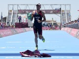 Azerbaijan's Rostyslav Pevtsov crosses the finish line to come third in the men's triathlon event at the 2015 European Games in Baku on June 14, 2015