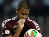 Venezuelan player Salomon Rondon celebrates after scoring against Peru, during their Brazil 2014 FIFA World Cup South American qualifying football match, at the Jose Antonio Anzoategui stadium in Puerto la Cruz, Venezuela on September 10, 2013