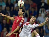 Spain's midfielder Sergio Busquets (L) vies for the ball with Belarus' midfielder Pavel Nekhaychik during the Euro 2016 group C qualifying football match between Belarus and Spain in Borisov, outside Minsk, on June 14, 2015