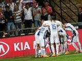 Slovakia's players celebrate the 2-0 goal during the Euro 2016 Group C qualifying football match Slovakia vs FYR Macedonia in Zilina, Slovakia on June 14, 2015