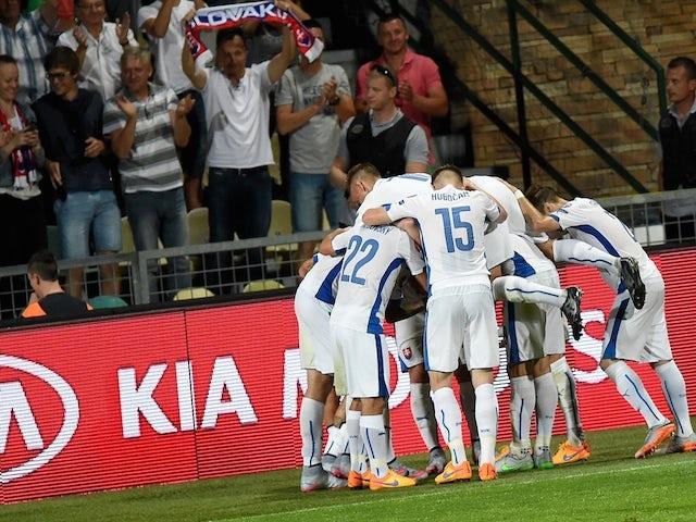 Slovakia's players celebrate the 2-0 goal during the Euro 2016 Group C qualifying football match Slovakia vs FYR Macedonia in Zilina, Slovakia on June 14, 2015