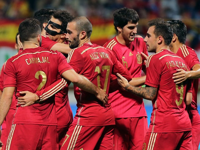 Spain's players celebrate a goal during the friendly football match Spain vs Costa Rica at the Reino de Leon stadium in Leon on June 11, 2015