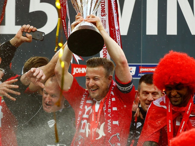 Wade Elliot of Bristol City lifts the trophy after the Johnstone's Paint Trophy Final between Bristol City and Walsall at Wembley Stadium on March 22, 2015