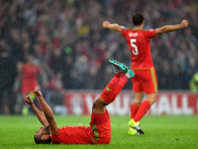 Wales captain Ashley Williams celebrates on the final whistle after the UEFA EURO Group B 2016 Qualifier between Wales and Belguim at Cardiff City stadium on June 12, 2015