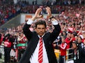 Chris Coleman the Wales manager waves to the crowd during the UEFA EURO 2016 qualifying match between Wales and Belgium at the Cardiff City Stadium on June 12, 2015