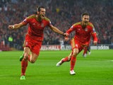 Wales player Gareth Bale celebrates after scoring the opening goal during the UEFA EURO Group B 2016 Qualifier between Wales and Belguim at Cardiff City stadium on June 12, 2015