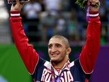 Gold medalist Abdulrashid Sadulaev of Russia stands on the podium during the medal ceremony for the Men's Wrestling 86kg freestyle on day six of the Baku 2015 European Games at the Heydar Aliyev Arena on June 18, 2015
