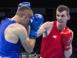 Ireland's Adam Nolan (red) fights with Albania's Alban Beqiri during the mens welter (69kg) round of 32 boxing fight at the 2015 European Games in Baku on June 17, 2015