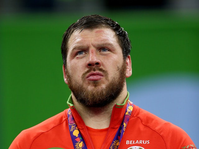 Silver medalist Aleksei Shemarov of Belarus stands on the podium during the medal ceremony for the Men's Wrestling 125kg freestyle on day six of the Baku 2015 European Games at the Heydar Aliyev Arena on June 18, 2015