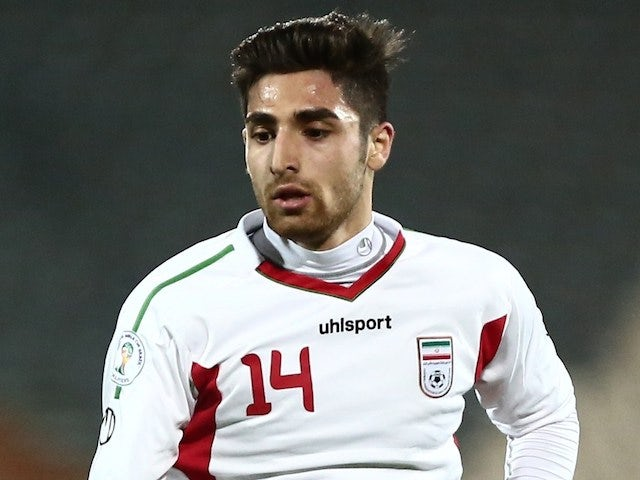Iran's Alireza Jahanbakhsh of Dutch Eredivisie club NEC plays during their internationaly friendly football match against Guinea at Azadi stadium in Tehran on March 5, 2014