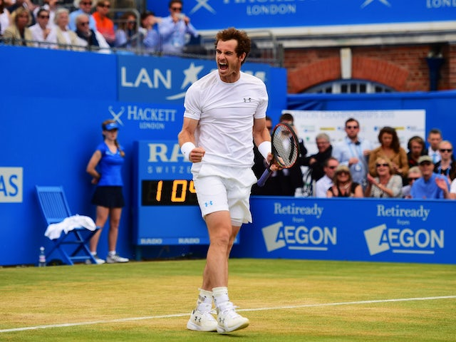Andy Murray of Great Britain celebrates victory in his men's singles final match against Kevin Anderson of South Africa during day seven of the Aegon Championships at Queen's Club on June 21, 2015