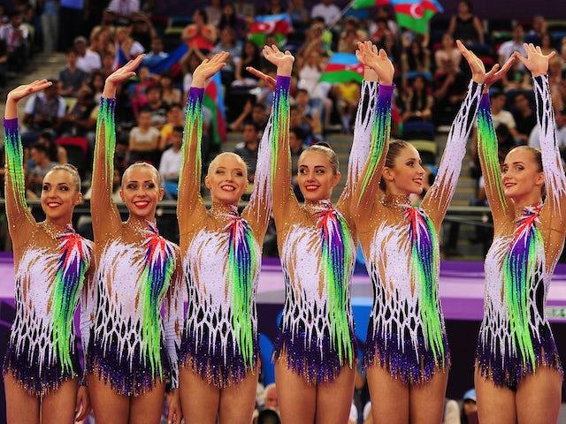 Gold medalists Ksenya Cheldishkina, Maria Kadobina, Valeriya Pischelina, Arina Tsitsilina and Hanna Dudzenkova of Belarus celebrate prior to receiving the medals won during the Rhythmic Gymnastics Group Clubs and Hoop final on day nine of the Baku 2015 Eu