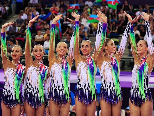 Gold medalists Ksenya Cheldishkina, Maria Kadobina, Valeriya Pischelina, Arina Tsitsilina and Hanna Dudzenkova of Belarus celebrate prior to receiving the medals won during the Rhythmic Gymnastics Group Clubs and Hoop final on day nine of the Baku 2015 Eu
