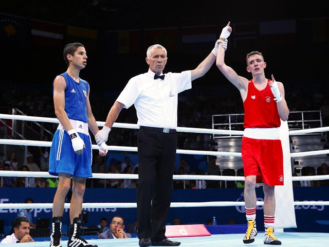 Brendan Irvine (red) of Ireland is declared the winner over Tinko Banabakov (blue) of Bulgaria in the Men's Boxing Light Fly weight 46-49kg round of 16 bout during day seven of the Baku 2015 European Games at the Crystal Hall on June 19, 2015