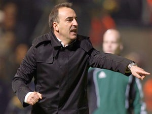 Besiktas JK Head Coach Carlos Carvalhal reacts during his team's UEFA Europa League group E qualifying football match against Maccabi Tel-Aviv at the Bloomfield Stadium in Tel Aviv on December 1, 2011