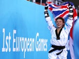 Charlie Maddock celebrates with the Union Jack after winning taekwondo gold for Team GB at the European Games on June 16, 2015