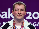 Gold medalist Christian Reitz of Germany poses with the medal won during the Men's Shooting 25m Rapid Fire Pistol on day nine of the Baku 2015 European Games at the Baku Shooting Centre on June 21, 2015