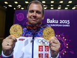 Gold medalist Damir Mikec of Serbia poses with the medals won during the Men's Pistol Shooting 50m final and 10 m final on day eight of the Baku 2015 European Games at the Baku Shooting Centre on June 20, 2015