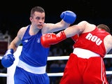 Darren O'Neill (blue)of Ireland and Ionut Jitaru (red) of Romania compete in the Men's Boxing Heavyweight 91kg during day four of the Baku 2015 European Games at Crystal Hall on June 16, 2015