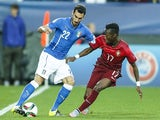 Davide Zappacosta of Italy (L) competes for the ball with Carlos Mane of Portugal during the UEFA Under21 European Championship 2015 match between Italy and Portugal at Mestsky Fotbalovy Stadium on June 21, 2015