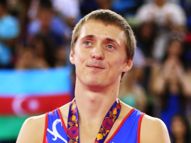 Gold medalists Dmitry Ushakov of Russia stand on the podium during the medal ceremony for the Men's Synchronised Trampoline final on day nine of the Baku 2015 European Games at the National Gymnastics Arena on June 21, 2015