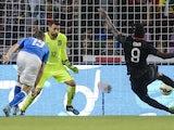 Portugal's forward Eder (R) scores the team's first goal against Italy's goalkeeper Salvatore Sirigu (C) and Italy's defender Leonardo Bonucci during the friendly game Portugal against Italy on the Stade de Geneve on June 16, 2015