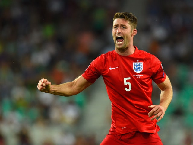 Gary Cahill of England celebrates after Jack Wilshere of England scored their first goal during the UEFA EURO 2016 Qualifier between Slovenia and England on at the Stozice Arena on June 14, 2015