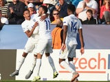 Jesse Lingard of England celebrates scoring to make it 1-0 with Nathan Redmond during the UEFA Under21 European Championship 2015 match between Sweden and England at Andruv Stadium on June 21, 2015