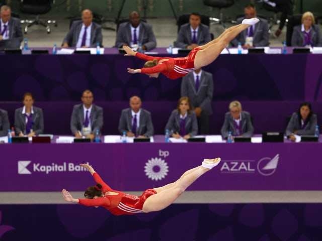 Katherine Driscoll and Laura Gallagher of Great Britain compete in the Women's Gymnastics Synchronised Trampoline Qualification during day seven of the Baku 2015 European Games at the National Gymnastics Arena on June 19, 2015
